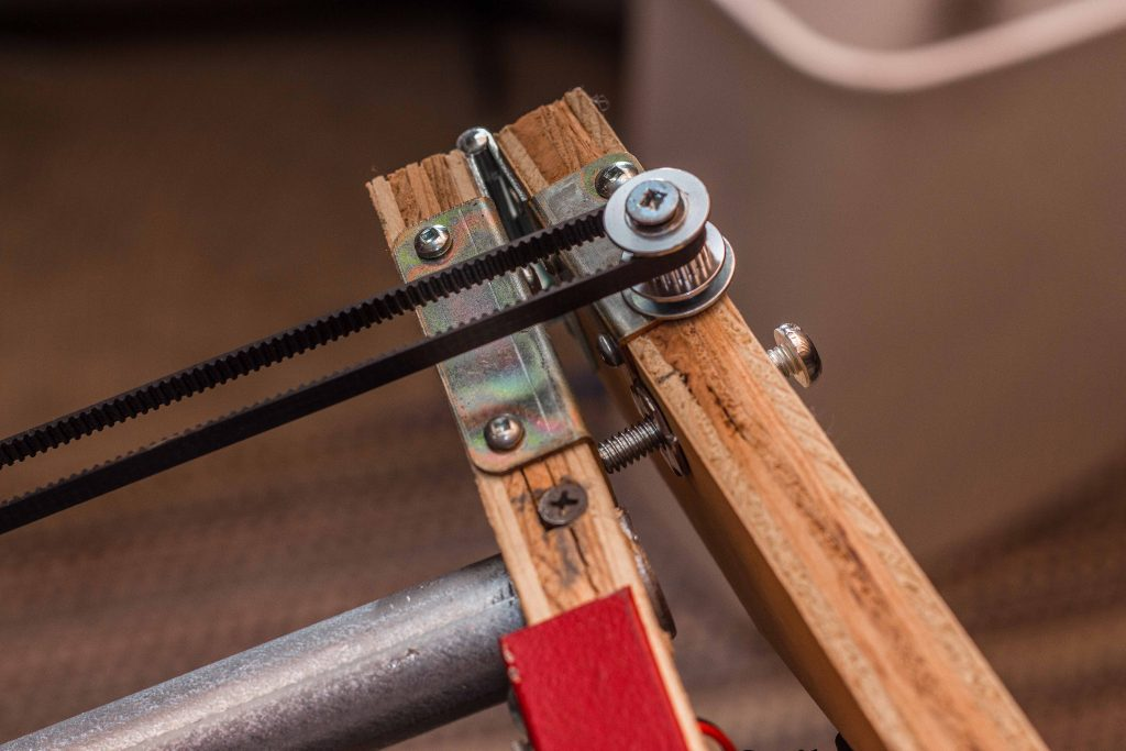This bolt adjusts belt tension